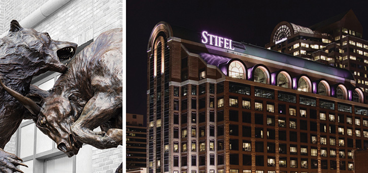 Stifel Bull and Bear Stature and Stifel Headquarter Building at night located in St. Louis, Missouri.